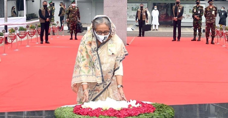 The Prime Minister pays homage to the portrait of Bangabandhu